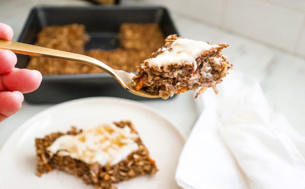 Carrot Cake Baked Oatmeal With Coconut Butter Frosting featured by top US wellness blogger, Elizabeth Finch Wellness