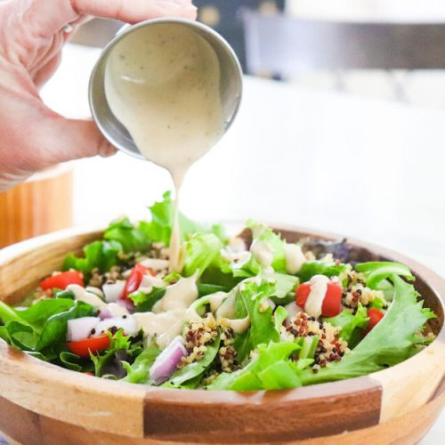 Easy Tahini Caesar Dressing Recipe featured by top US wellness blogger, Elizabeth Finch Wellness
